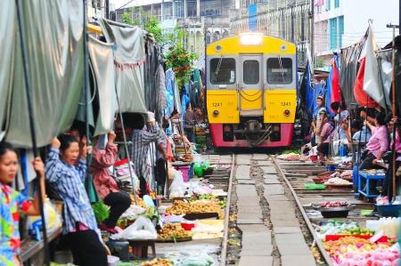 MAEKLONG, THAILAND-AUG 20  The famous railway markets at Maeklong, Thailand, August 20 th, 2012, Bangkok, Thailand Three times a day the train runs through these stalls