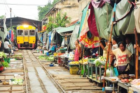 ancient pass: MAEKLONG, THAILAND-AUG 20  The famous railway markets at Maeklong, Thailand, August 20 th, 2012, Bangkok, Thailand Three times a day the train runs through these stalls