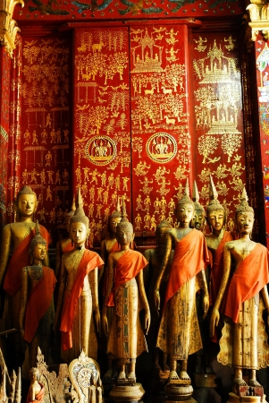 Buddha statues in Wat Xieng Thong in Luang Prabang , Laos ,South East Asia  Stock Photo