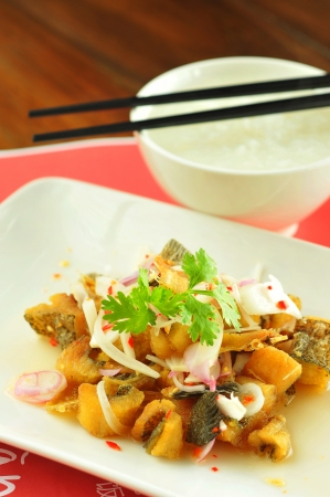 Fried fish hot and spicy thai style and gruel  Banco de Imagens