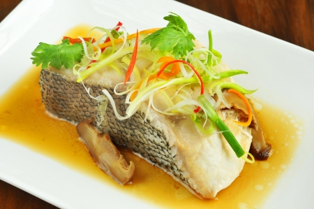 chinese food: Fish in soy sauce, served on white plate ,chinese style
