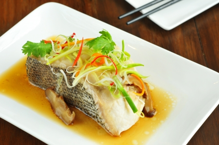 Fish in soy sauce, served on white plate ,chinese style