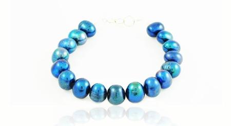 Blue pearls bracelet isolated on white