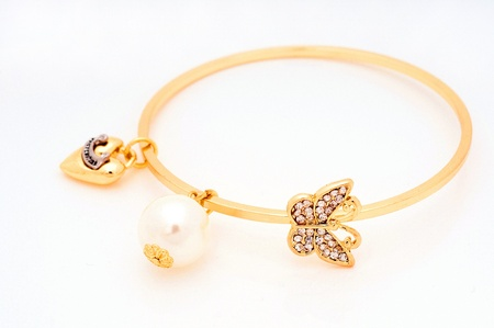 Gold bracelet in the white, luxury concept