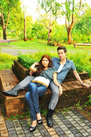 Beautiful happy couple in the park in sunny summer day   photo