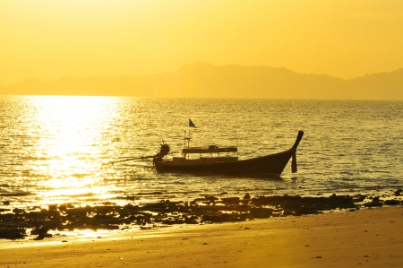 Thailand fisher boat at sunset  photo