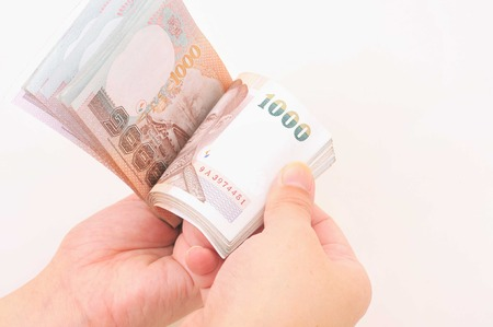 Hand with money isolated on a white background  photo