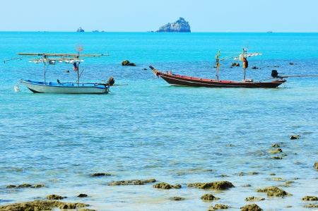 Fishing boats moored along the beach photo