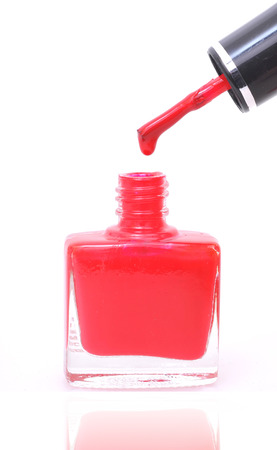 applicator: dripping nail polish isolated on white background  Stock Photo