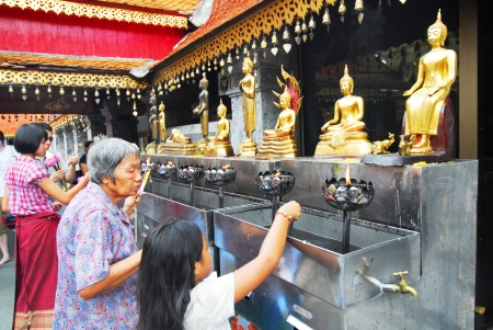 CHIANGMAI - OCTOBER 14 Tourists come to pray at the Doi Suthep Temple in Chiang Mai, Thailand on October 14, 2012  The temple founded in 1385 is a major tourist attraction in Chiang Mai