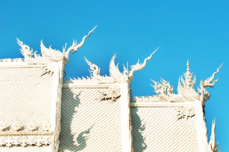 beautiful white buddhist temple roof in chiang rai, thailand  photo