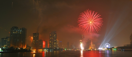 Bangkok, capital city of Thailand at night and firework in the middle of the river  photo