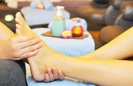 Enjoying and relaxing healthy foot massage  photo