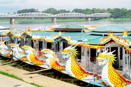 HUE, VIETNAM - MAY 12  Dragon boats waiting for tourist in the morning on May 12, 2011 in Hue city, Vietnam  Between 1802 and 1945, Hue was the imperial capital of the Nguyen dynasty