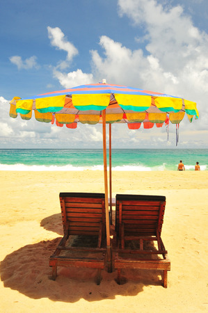Beach chairs with umbrella and beautiful beach on a sunny day photo