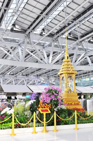 world's: BANGKOK- JULY 1   Small Thai golden throne at Suvanaphumi Airport, Bangkok on July 1, 2014  Suvarnabhumi airport is world s 4th largest single-building airport terminal