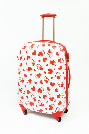 Travel luggage isolated on the white background photo