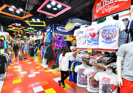 BANGKOK - OCT 9: Shoppers visits MBK Center on Oct 9, 2014 in Bangkok, Thailand. MBK is one of the oldest malls in SE Asia and is currently home to over 2000 retail outlets and services.