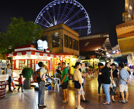 BANGKOK-August 23: Unidentified people visit Asiatique The Riverfront at night on August 23, 2014 in Bangkok, Thailand. There are more than 500 outdoor shopping stores in Asiatique The Riverfront.