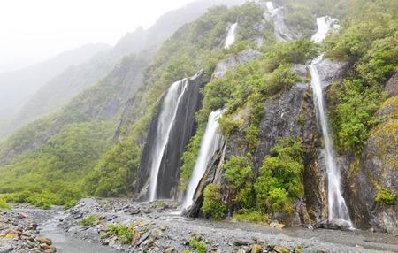 franz josef: Waterfall in Franz Josef Glacier Valley Stock Photo