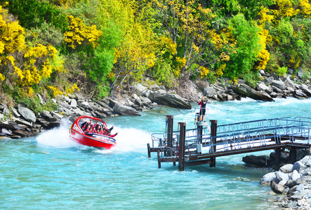 QUEENSTOWN, NEW ZEALAND -  November 18: Tourists enjoy a high-speed boat ride on Queenstown
