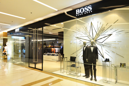 paragon: BANGKOK - DEC 29: Boss store in Siam Paragon Shopping mall in Bangkok on December 29, 2014. It is one of the biggest shopping centres in Asia