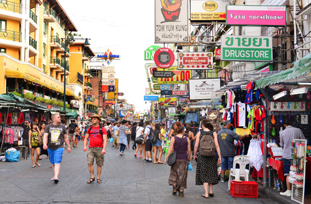 BANGKOK - January 7: Unidentified tourists walk along backpacker haven Khao San Road on January 7, 2015 in Bangkok, Thailand. Budget accommodation on Khao San Road starts from $8 or B250 per night