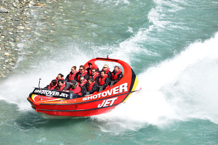 QUEENSTOWN, NEW ZEALAND - November 18: Tourists enjoy a high-speed boat ride on Queenstown\