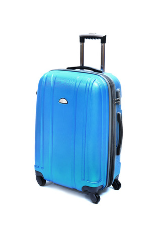Travel luggage isolated on the white background Foto de archivo