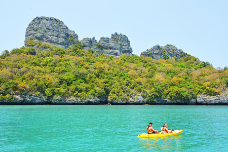 padding: Ang Thong National Marine Park- March 18 : two undefined traveler are padding a kayak  in front of the island on March 18, 2015 Editorial