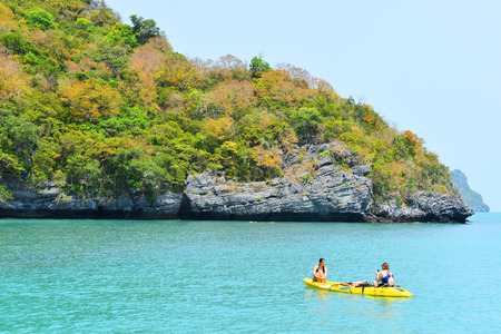 padding: Ang Thong National Marine Park- March 18 : two traveler are padding a kayak in front of the island on March 18, 2015 Editorial
