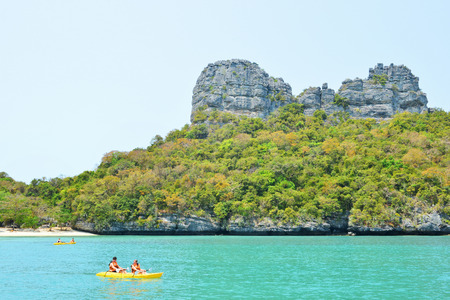 padding: Ang Thong National Marine Park- March 18 : two undefined traveler are padding a kayak in front of the island on March 18, 2015