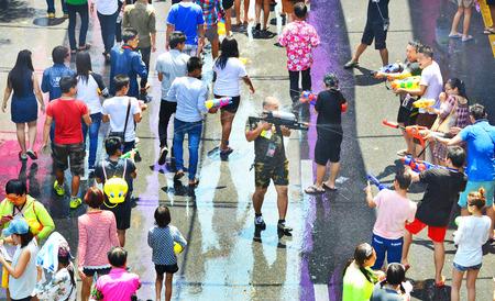silom: BANGKOK THAILAND  APRIL 15 2015: people playing water in Songkran festival on April 15 2015 at Silom road in Bangkok