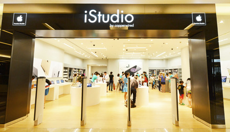 6 people: BANGKOK  June 6: People shopping in Istudio shop Siam Paragon on June 6 2015. It is a premium reseller of Apple Inc in Thailand.