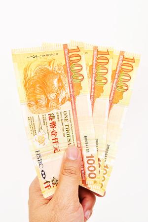 Hand with three of 1000 HongKong Dollars banknote