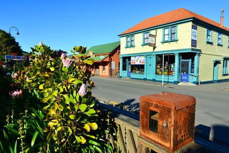 nz: AKAROA, NEW ZEALAND-NOV24: Akaroa village on Nov24, 2014 in Akaroa, NZ. Akaroa is a historic French and British settlement nestled in the heart of an ancient volcano on Banks Peninsula, NZ.