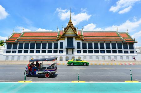 tuktuk: BANGKOK, THAILAND - August 14, 2015: TukTuk,Taxi on road in front of the famous Buddhist Temple Wat Phra Kaew, one of the main landmarks of Bangkok, Thailand