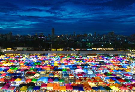 above 21: BANGKOK - August 21, 2015: View from above of a night market in Huay Khwang district, Bangkok.