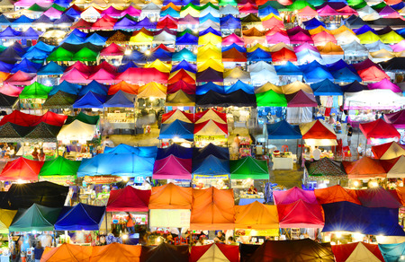 tent city: BANGKOK - August 21, 2015: View from above of a night market in Huay Khwang district, Bangkok.