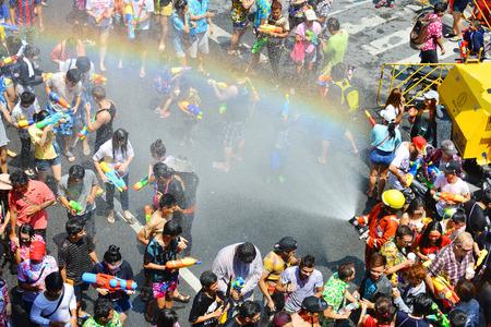 silom: BANGKOK, THAILAND - APRIL 15, 2015: people playing water in Songkran festival on April 15, 2015 at Silom Road in Bangkok. Editorial