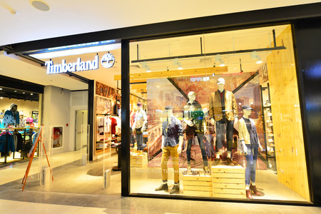 retailer: Nonthaburi Thailand -  Aug 28, 2015: Central Westgate Timberland store.Timberland LLC is a manufacturer and retailer of outdoors clothing and footwear.This American company operates stores worldwide. Editorial