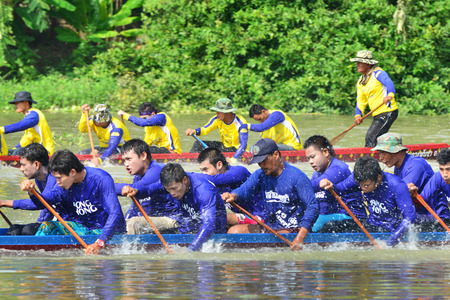 watersport: AYUTTHAYA, THAILAND - SEP 20 : Unidentified crew in traditional Thai long boats competition on September 20, 2015,Ayutthaya, Thailand.