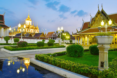 prasat: Reflection of Loha Prasat with twilight time at Ratchanaddha temple, Bangkok, Thailand