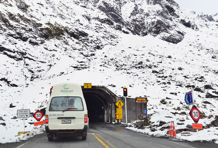 homer: FIORDLAND,NZ - November 20 :Cars enter Homer Tunnel on Nov 20 2014.Its a 1.2km 0.75 miles road tunnel and until it was sealed and enlarged it was the longest gravel-surfaced tunnel in the world.
