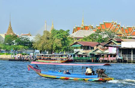 phraya: Tourists boats on Chao Phraya river,Bangkok, Thailand.