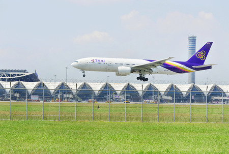airway: BANGKOK THAILAND -January 30, Thai airway plane landing to runways at suvarnabhumi international air port on January 30, 2016 in Bangkok, Thailand. Editorial
