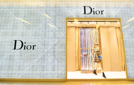 light duty: BANGKOK - JAN 25: Front view of Dior store on January 25, 2016 in Siam Paragon Bangkok, Thailand. It is a French company controlled and chaired by Bernard Arnault who also heads Louis Vuitton. Editorial