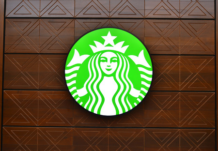 famous industries: THAILAND - FEBRUARY 8: Starbucks Coffee coffeehouse at Maharaj Pier, Chao Phraya riverside on February 8, 2016 in Bangkok, Starbucks is the largest coffeehouse company in the world.