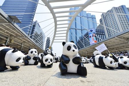 wwf: Bangkok, Thailand - March 8, 2016: 1600 paper Mache Pandas campaign showcase in Bangkok by WWF to promote environmental preservation.