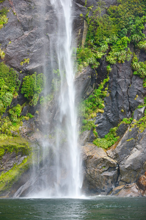 fiord: Waterfall of Milford Sound fiord, Fiordland National Park, New Zealand,wind and weather Editorial